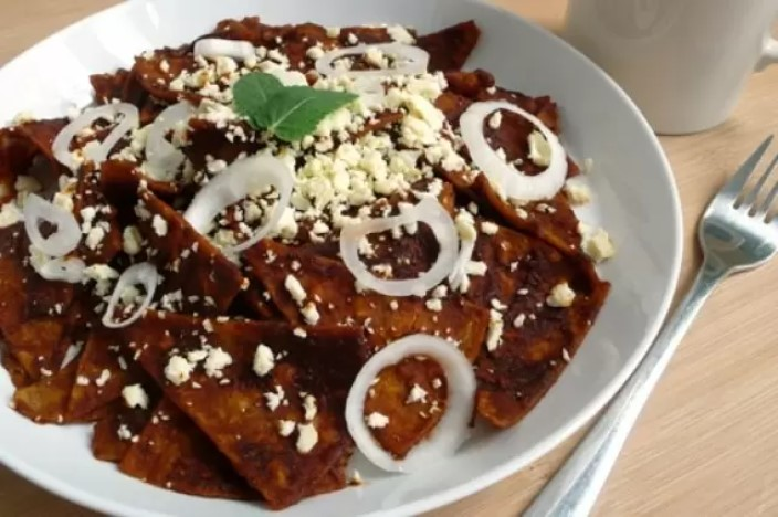 Chilaquiles de mole is a traditional Mexican dish