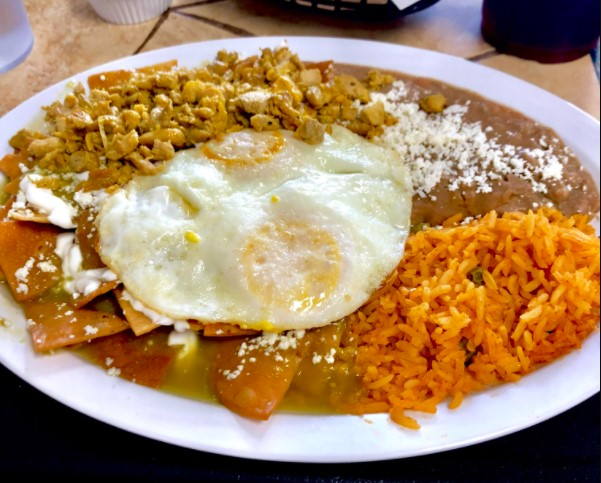 Chilaquiles taco with rice and beans.