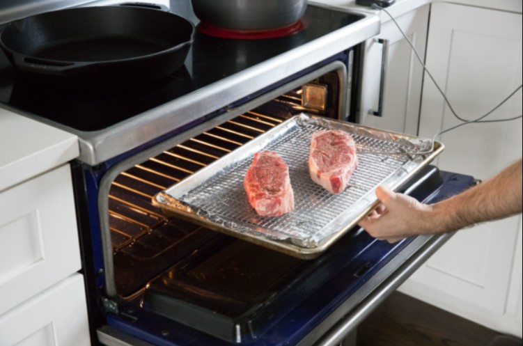 Cook meat in the oven