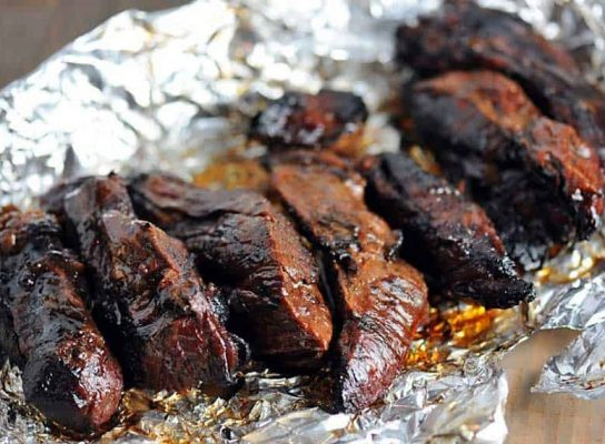 Grilled ribs in foil