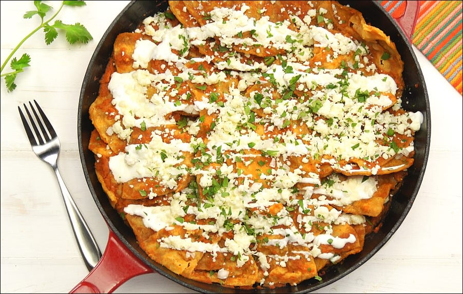 Sprinkle salsa over chilaquiles