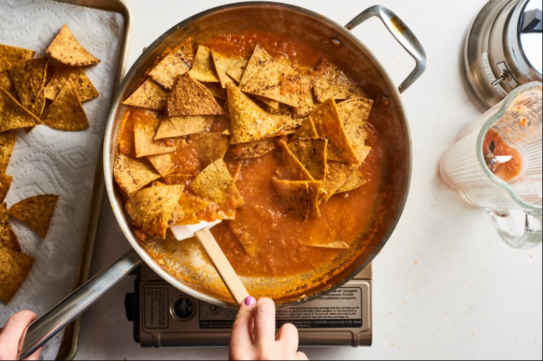 Add cheese to chilaquiles recipe